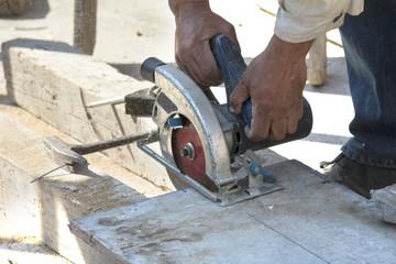 Man cutting wood by machine