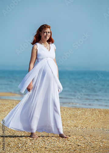 beauty pregnant woman on sea beach