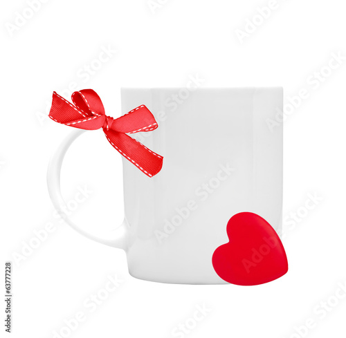 white cup with red ribbon bow and heart on white background