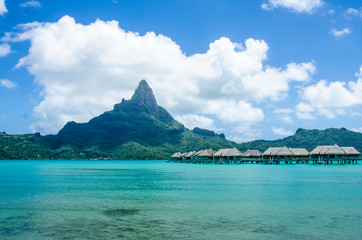 Overwater bungalows in Bora Bora with view of Mount Otemanu