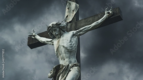 Crucifixion. Christian cross with Jesus Christ statue