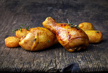Roasted chicken legs and potatoes