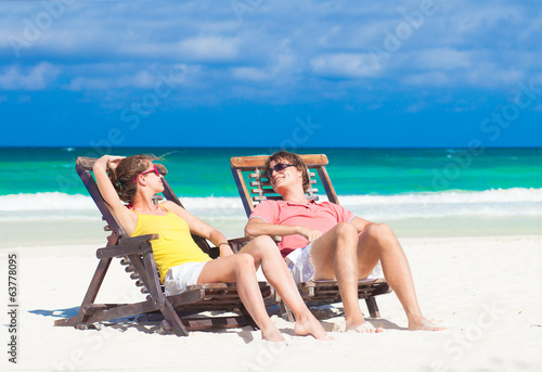Happy Romantic Couple Enjoying the Sun at the Beach Looking at