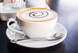 Coffee cup and saucer on black table