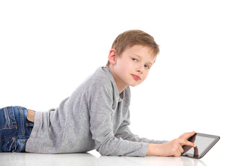Boy posing with a tablet.
