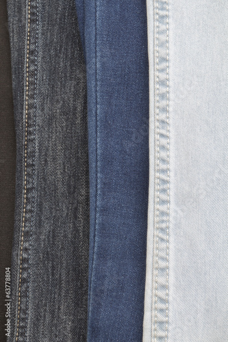 The multi-colored jeans hanging in a row