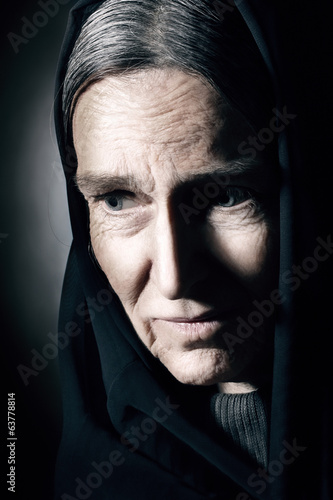Old woman wrinkled face. Sad senior woman