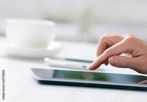 Woman hand with tablet PC