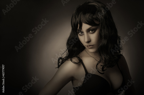 Dark portrait of sensual woman brunette