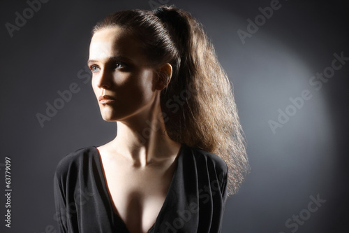 Young woman portrait with ponytail