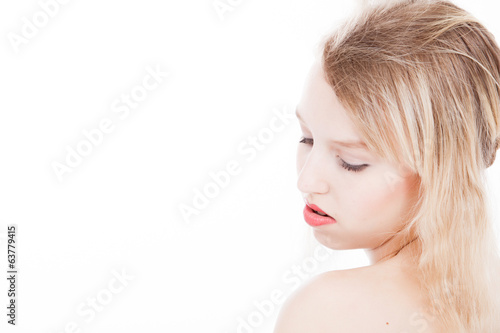Serene blond teenager on white