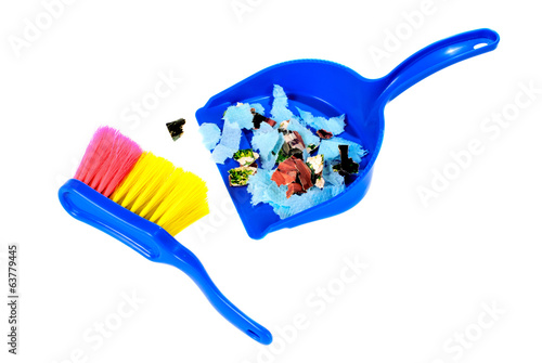 Brush and scoope with garbage isolated