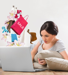 Woman shopping online laptop home