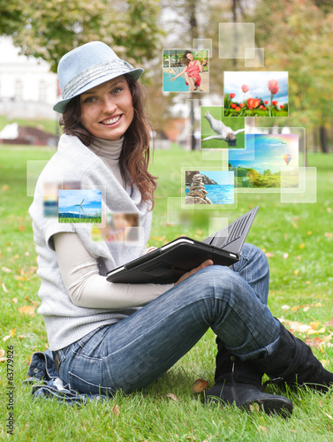 Woman sharing photo social media using tablet computer