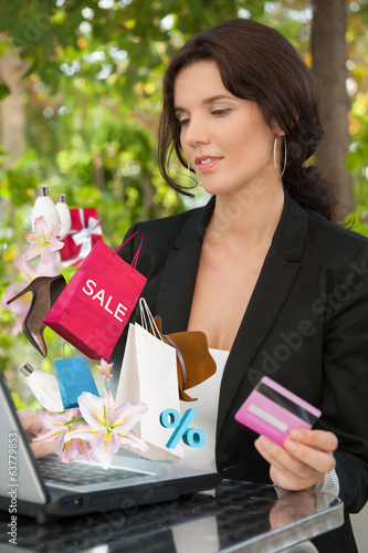 Woman shopping online laptop credit card