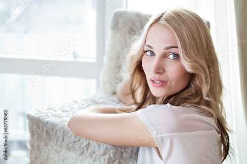Portrait of a beautiful female model  near window