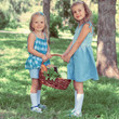 Two little girls carrying basket with organic food