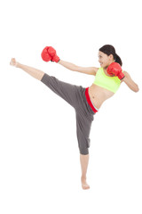 pretty sporty woman is kicking and punching