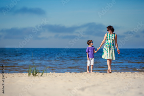 Young mother and her son on beach vacation