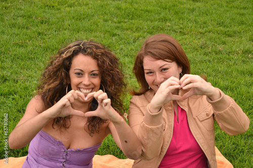 Two young women fun in park