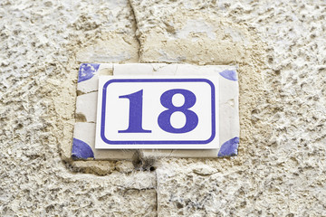 Number eighteen on a wall