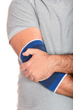 Man with a therapeutic elastic band on his elbow poster