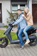 Attractive young teenage couple on a motorcycle