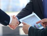 Fototapety Business associates shaking hands in office