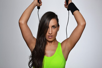 beautiful fitness woman jumping rope