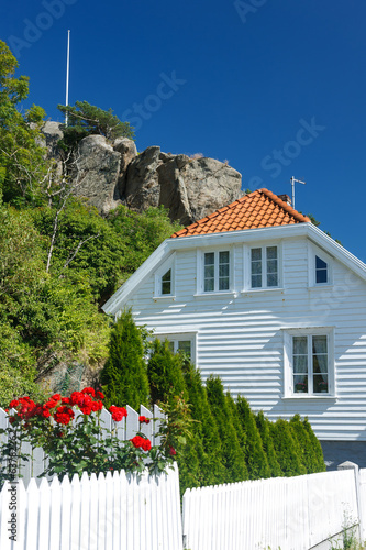 Traditional white wooden house in Norway