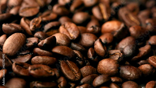 Coffee bean background. Sliding camera