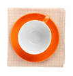 canvas print picture - Orange coffee cup over kitchen towel