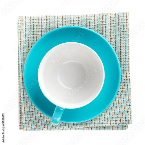 Blue coffee cup over kitchen towel