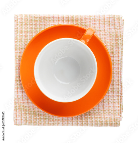 Orange coffee cup over kitchen towel