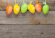 canvas print picture - Easter eggs on wooden table background
