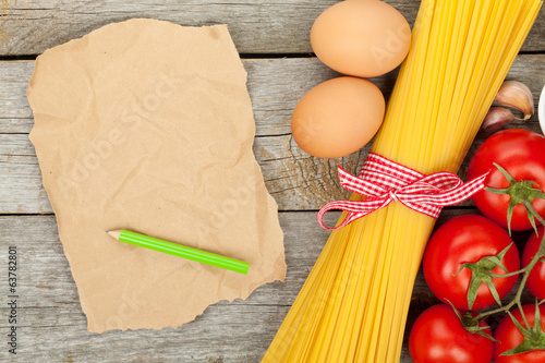 Pasta, tomatoes, eggs and blank brown paper