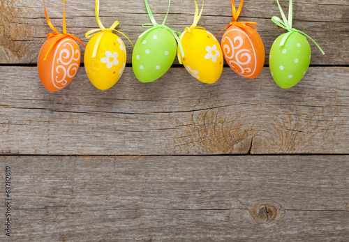 canvas print picture Easter eggs on wooden table background
