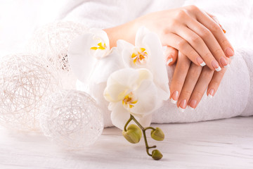 beautiful french manicure with white orchid