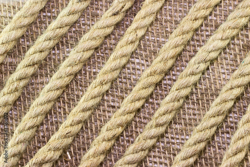 Jute rope on burlap background