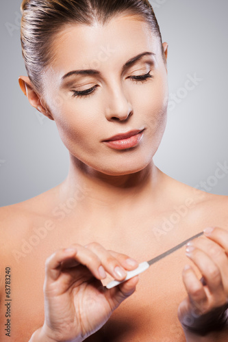 Woman polishing nails.