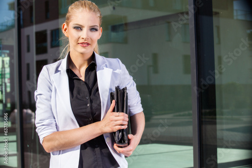 Businesswoman with briefcase in an urban setting