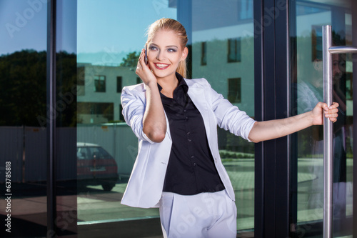 Young businesswoman using mobile phone on street