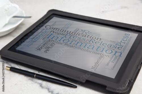 tablet with public relation word cloud