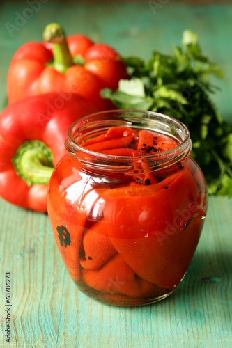 grilled red bell pepper in a glass jar