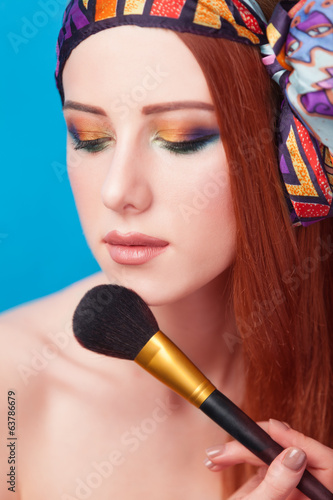 Redhead women with brush