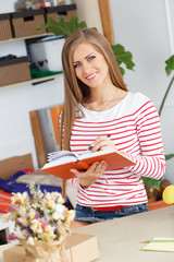 Lifestyle. Attractive girl with notepad