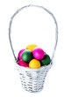 Colorful easter eggs in basket isolated on white background clos