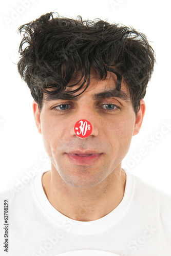 Man with discount sticker on nose