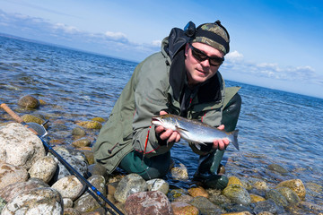 Happy angler with sea trout trophy