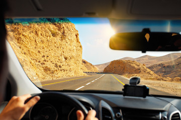 Driving a car on mountain road to Dead Sea